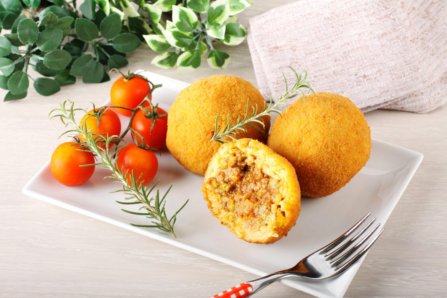 Scopri come fare gli arancini siciliani di riso